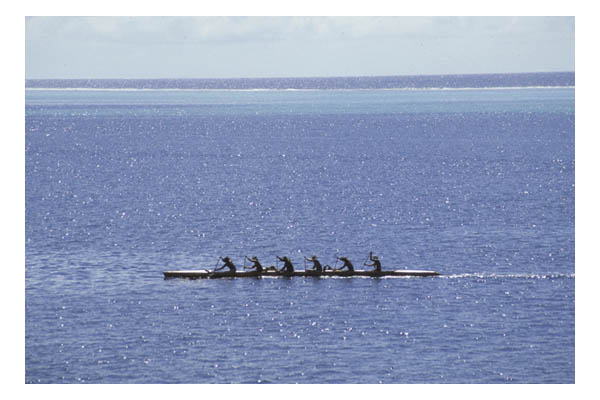 Raiatea (in Society Island, French Polynesia, S. Pacific)—6 men in outrigger canoe amid shimmering blue S. Pacific