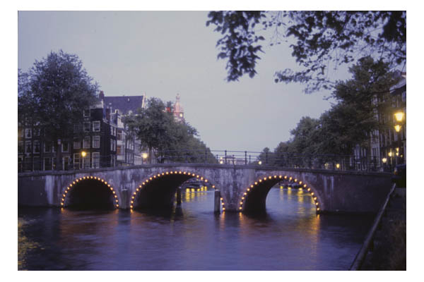 Dusk, bridge with lights over Herringgracht Canal, Amsterdam, The Netherlands