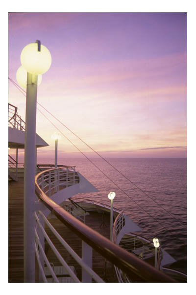 Rails and lamps at stern of cruise ship, at dusk.